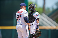 Jacksonville Jumbo Shrimp relief pitcher Tyler Stevens (33) talks with catcher Rodrigo Vigil (1) during a Southern League game against the Tennessee Smokies on April 29, 2019 at Baseball Grounds of Jacksonville in Jacksonville, Florida.  Tennessee defeated Jacksonville 4-1.  (Mike Janes/Four Seam Images)