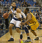 Nevada forward Cody Martin (11) is guarded by California Baptist guard Milan Acquaah  (0) in the first half of an NCAA college basketball game in Reno, Nev., Monday, Nov. 19, 2018. (AP Photo/Tom R. Smedes)