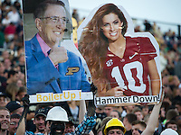Purdue students hold up photos of Katherine Webb and Brent Musberger.