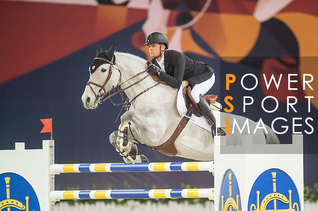 Jerome Guery of Belgium riding Papillon Z competes during the Hong Kong Jockey Club Trophy competition, part of the Longines Masters of Hong Kong on 10 February 2017 at the Asia World Expo in Hong Kong, China. Photo by Juan Serrano / Power Sport Images