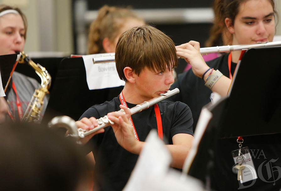 NWA Democrat-Gazette/DAVID GOTTSCHALK -  Ayden Hunsperger, of Oak Grove, Okla., practices the flute with Band 8 on the campus of the University of Arkansas Tuesday, July 7, 2015 during the 58th Annual Summer Music Camp. Students are participating in the week long junior high band camp that is designed to increase performance skills and broaden the knowledge of the musicians through a comprehensive curriculum.