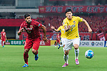 Shanghai FC Forward Givanildo Vieira De Sousa (Hulk) (L) fights for the ball with Jiangsu FC Defender Li Ang (R) during the AFC Champions League 2017 Round of 16 match between Shanghai SIPG FC (CHN) vs Jiangsu FC (CHN) at the Shanghai Stadium on 24 May 2017 in Shanghai, China. Photo by Marcio Rodrigo Machado / Power Sport Images