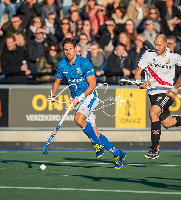 UTRECHT - Bjorn Kellerman (Kampong) met rechts Justin Reid-Ross (Adam)  tijdens  de hoofdklasse hockeywedstrijd mannen, Kampong-Amsterdam (4-3).  COPYRIGHT KOEN SUYK