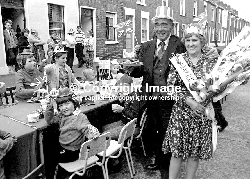 Shankill Road, Belfast, residents celebrate the Silver Jubilee of Queen Elizabeth II with a party in Matchett Street.  With John McQuade, aka Johnny McQuade, who was the local MP until the N Ireland Parliament was abolished in 1973 is pictured with the Shankill Jubilee Queen, name not known, can you help?  Taken: 7th June 1977. 197706070089f<br />