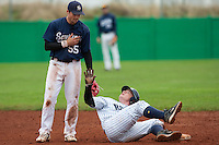 10 october 2009: David Gauthier of Rouen lays down on second base and watches Florian Peyrichou of Savigny during game 4 of the 2009 French Elite Finals won 7-2 by Huskies of Rouen over Lions of Savigny, at Stade Jean Moulin stadium in Savigny sur Orge, near Paris, France. Rouen wins the 2009 France championship, his sixth title.