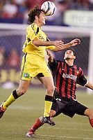 The Crew's Duncan Oughton goes up for a header as the MetroStars' Pablo Brenes watches. The MetroStars and the Columbus Crew played to a 1-1 tie at Giant's Stadium, East Rutherford, NJ on Sunday August 29, 2004.
