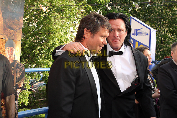 "Oleg Taktarov, Michael Madsen.Producing the movie ""The Prophet: Mission of the fifth angel"", Moscow, Russia..May 19th, 2009.half length white shirt tuxedo bow tie arm over shoulder profile tongue black.CAP/PER/LS.©AL/PersonaStars/CapitalPictures"