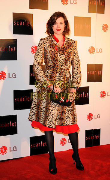 """JASMINE GUINNESS.""""Scarlet"""" - TV series launch, No. 1 Marylebone, Marylebone Road, London, England..April 30th, 2008.full length leopard print coat jacket black clutch bag red heart print.CAP/CAN.©Can Nguyen/Capital Pictures."""