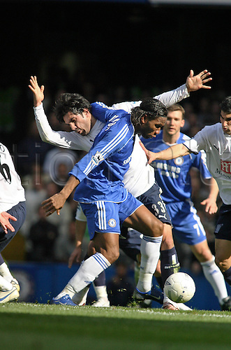 11 March 2007: Chelsea striker Didier Drogba competes with Ricardo Rocha for the ball during the FA Cup Quarter-Final game between Chelsea and Tottenham Hotspur, played at Stamford Bridge. The game ended 3-3. Photo: Actionplus....070311 football soccer player spurs