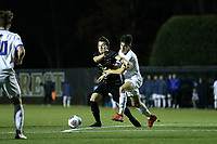 WINSTON-SALEM, NC - DECEMBER 07: Isaiah Parente #15 of Wake Forest University is defended by Mateo Restrepo Mejia #14 of the University of California Santa Barbara during a game between UC Santa Barbara and Wake Forest at W. Dennie Spry Stadium on December 07, 2019 in Winston-Salem, North Carolina.