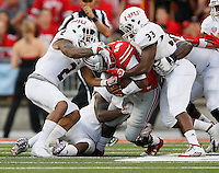 Ohio State Buckeyes quarterback J.T. Barrett (16) gets tackled by Northern Illinois Huskies safety Marlon Moore (2) and linebacker Jamaal Payton (33) during the fourth quarter of the NCAA football game at Ohio Stadium in Columbus on Sept. 19, 2015. (Adam Cairns / The Columbus Dispatch)