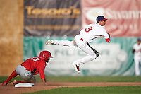 Auburn Doubledays shortstop Clayton Brandt (3) throws to first as Luis Espiritu, Jr. (33) slides into second during a game against the Williamsport Crosscutters on June 26, 2016 at Falcon Park in Auburn, New York.  Auburn defeated Williamsport 3-1.  (Mike Janes/Four Seam Images)