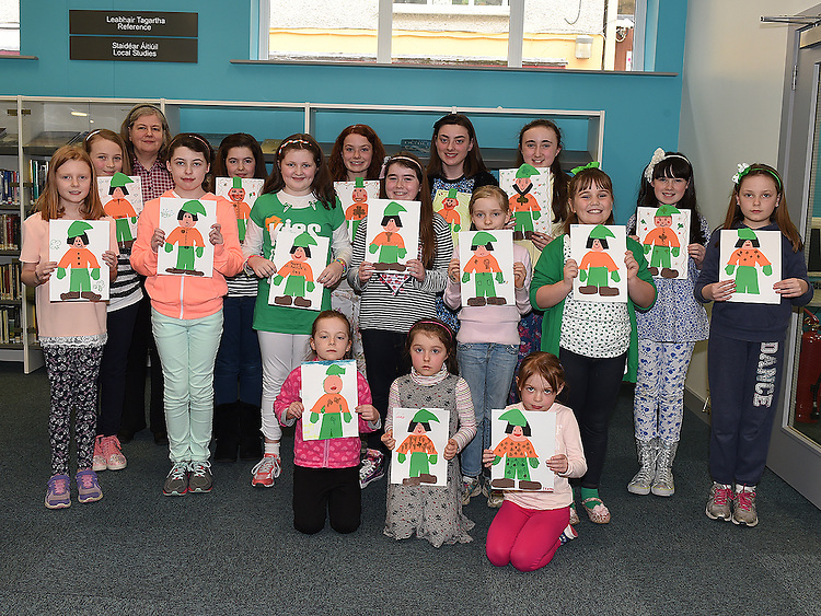 Drogheda Librarian Ann Keaveney pictured with the children who took part in the St Patrick's art session in the Library. Photo:Colin Bell/pressphotos.ie