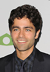 Adrian Grenier at the Pathway To The Cure for Breast Cancer A fundraiser benefiting Susan G. Komen held at private hangar at Santa Monica Airport Los Angeles, CA. June 11, 2014.