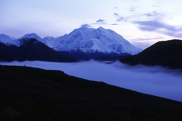 Fog moves through a valley in the foothills of Mount McKinley in Alaska's interior. The 20,320-foot mountain is North America's tallest peak and is located in Denali National Park.