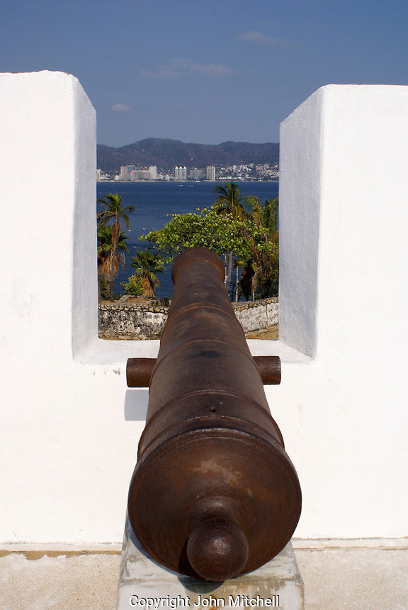 Spanish cannon overlooking Acapulco Bay at Fuerte de San Diego, Acapulco, Mexico. This 18th-century Spanish fort was built to protect Acapulco from Dutch and English buccaneers.