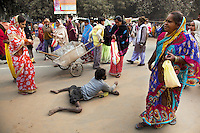 India. Uttar Pradesh state. Allahabad. Maha Kumbh Mela. A poor man, who suffered polio in his childhood, in lying on his stomach and begging money to people on one of the mains roads to Sangam. A man pulls a cart because he works as a street cleaner. An advertisement for the program to various speeches in Guru's tent. The Kumbh Mela, believed to be the largest religious gathering is held every 12 years on the banks of the 'Sangam'- the confluence of the holy rivers Ganga, Yamuna and the mythical Saraswati. The Maha (great) Kumbh Mela, which comes after 12 Purna Kumbh Mela, or 144 years, is always held at Allahabad. Uttar Pradesh (abbreviated U.P.) is a state located in northern India. 6.02.13 © 2013 Didier Ruef