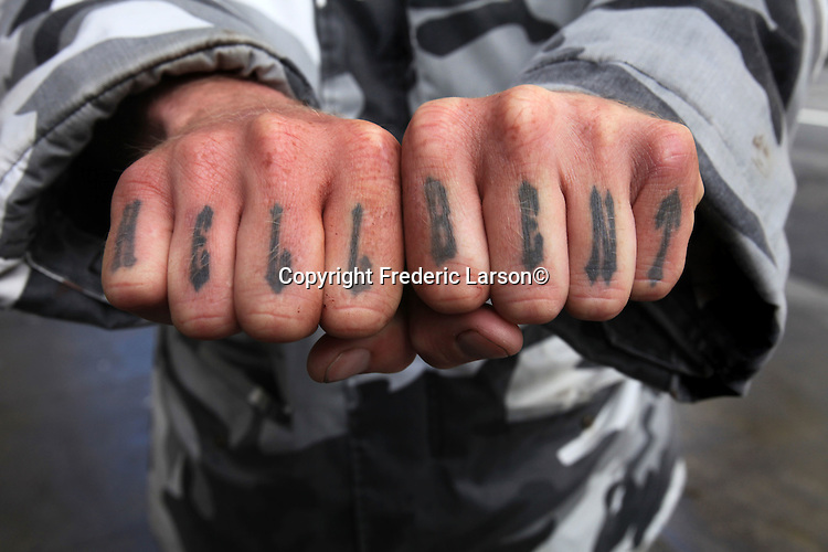 """Jeff was """"Hell Bent"""" in showing off his tattoos on his fingers while hanging out in the Tenderloin district of San Francisco, California."""