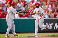 Ronny Gil (73) of the St. Louis Cardinals is congratulated by Third Base coach Jose Oquendo (11) after hitting a home run to right field during a game against the Springfield Cardinals at Hammons Field on April 2, 2012 in Springfield, Missouri. (David Welker/Four Seam Images).