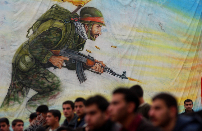 For the attention of foreign pix-For story by Neil MacFarquhar-Crowds at a Hezbollah celebration of Jerusalem day in the town of Nabatieh in south Lebanon waited for the parade to begin with the backdrop of a Hezbollah fighter behind them.<br />