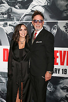 "LOS ANGELES - JAN 17:  Daughter, Mark Canton at the ""Den of Thieves"" Premiere at Regal LA Live Theaters on January 17, 2018 in Los Angeles, CA"