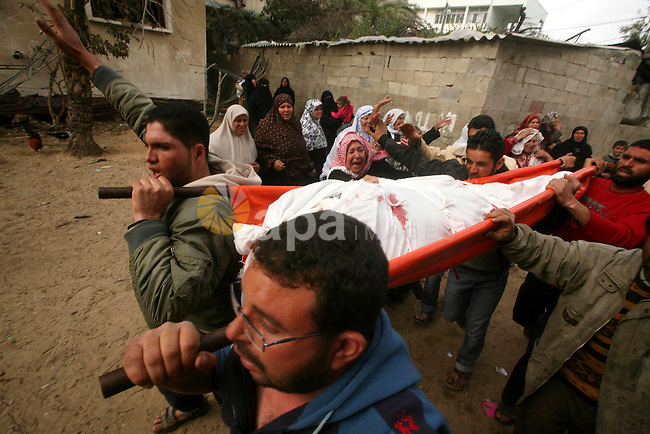 Palestinian carry the body of Mohammed al-Hasoma, 65, killed in an Israeli air strike during his funeral in Beit Lahiya, northern Gaza Strip, Monday, March 12, 2012. The cross-border violence, touched off by Israel's killing of a top militant leader on Friday, has been the worst exchange of fire between Israel and the Hamas-ruled territory in months. Photo by Ashraf Amra