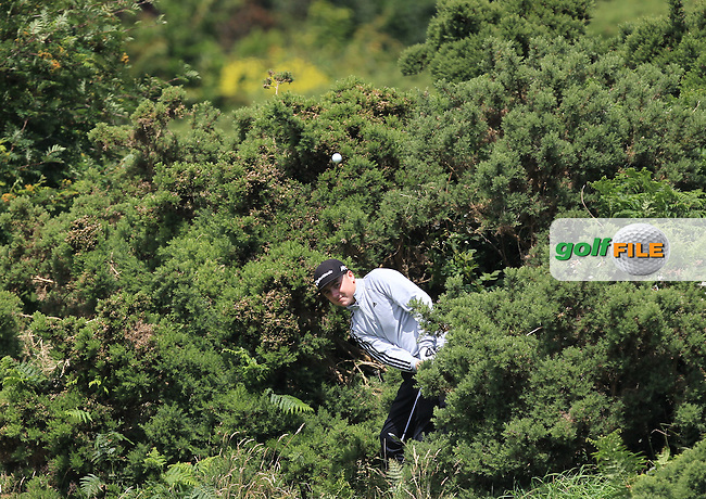 Darragh Smith (Castle) in the rough on the 17th during Round 3 of the 2016 Connacht U18 Boys Open, played at Galway Golf Club, Galway, Galway, Ireland. 07/07/2016. <br /> Picture: Thos Caffrey | Golffile<br /> <br /> All photos usage must carry mandatory copyright credit   (&copy; Golffile | Thos Caffrey)
