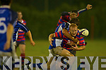Shane Flynn Castleisland bursts through Trevor West Killorglin tackle during their game in the Crageen's Castleisland Saturday evening   Copyright Kerry's Eye 2008