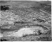Elevated view of Durango from Smelter Hill showing smelter remains, D&amp;RGW facilities and Durango town.  It predates April, 1968 when the turning loop was installed.<br /> Durango, CO  before 1968