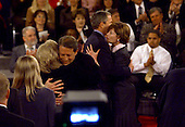 United States Vice President Al Gore embraces his wife, Tipper, left, and Governor George W. Bush (Republican of Texas) embraces his wife, Laura, right, following their third and final debate at the Field House at Washington University in St. Louis, Missouri on October 17, 2000.<br /> Credit: Dennis Brack / Pool via CNP
