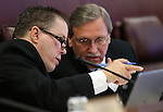 Nevada Assembly Republicans John Moore, left, and John Ellison work in committee at the Legislative Building in Carson City, Nev., on Wednesday, Feb. 25, 2015. <br /> Photo by Cathleen Allison