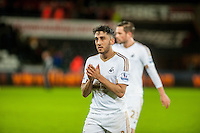 Neil Taylor of Swansea applauds fans at final whistle of during the Barclays Premier League match between Swansea City and Sunderland played at the Liberty Stadium, Swansea  on  January the 13th 2016