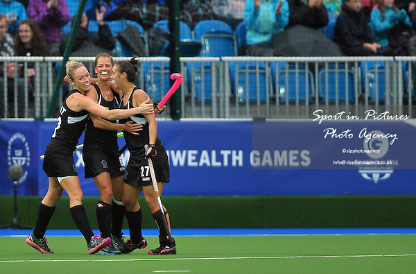 Goalscorer Jordan Grant (NZL, 27) is congratulated by Anita Punt (NZL, left) and Petrea Webster (NZL). South Africa (RSA) v New Zealand (NZL). Womens bronze medal match. Hockey. PHOTO: Mandatory by-line: Garry Bowden/SIPPA/Pinnacle - Tel: +44(0)1363 881025 - Mobile:0797 1270 681 - VAT Reg No: 183700120 - 020814 - Glasgow 2014 Commonwealth Games - Glasgow national hockey centre, Glasgow, Scotland, UK