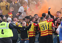 Partick Thistle fans celebrating in the SPFL Ladbrokes Championship football match between Queen of the South and Partick Thistle at Palmerston Park, Dumfries on  4.5.19.