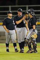 Richard Marshall #23 (center) of the Bristol White Sox is congratulated by his catcher Chase Blackwood #26 after defeating the Burlington Royals 3-0 in 12 innings at Burlington Athletic Stadium August 13, 2010, in Burlington, North Carolina.  Photo by Brian Westerholt / Four Seam Images