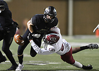 NWA Democrat-Gazette/CHARLIE KAIJO Bentonville wide receiver Trenton Kolb (21), carries the ball, stripped  by Springdale cornerback Gabriel Bucao (27), Friday, November 1, 2019 during a football game at Bentonville High School in Bentonville.