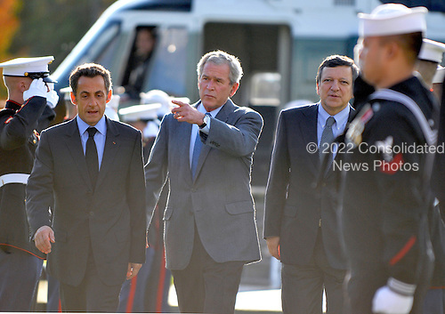 Camp David, MD - October 18, 2008 --  United States President George W. Bush, center, gestures to the podium as he welcomes President Nicolas Sarkozy of France, who also serves as this year's rotating President of the European Union (EU), left, and President José Manuel Barroso of the European Commission (EC), right, at the Presidential Retreat near Thurmont, Maryland for talks on Saturday, October 18, 2008.  The two European leaders stopped at Camp David to meet with President Bush to discuss the economy on their way home from a summit in Canada to try to convince Bush to support a summit by year's end to try to reform the world financial system..Credit: Ron Sachs / Pool via CNP