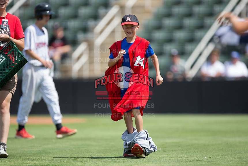 A young fan competes in a dress up race between innings of the South Atlantic League game between the Hagerstown Suns and the Kannapolis Intimidators at Kannapolis Intimidators Stadium on July 9, 2017 in Kannapolis, North Carolina.  The Intimidators defeated the Suns 3-2 in game one of a double-header.  (Brian Westerholt/Four Seam Images)