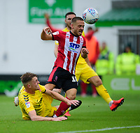 Lincoln City's Jack Payne is tackled by Fleetwood Town's Peter Clarke<br /> <br /> Photographer Andrew Vaughan/CameraSport<br /> <br /> The EFL Sky Bet League One - Lincoln City v Fleetwood Town - Saturday 31st August 2019 - Sincil Bank - Lincoln<br /> <br /> World Copyright © 2019 CameraSport. All rights reserved. 43 Linden Ave. Countesthorpe. Leicester. England. LE8 5PG - Tel: +44 (0) 116 277 4147 - admin@camerasport.com - www.camerasport.com