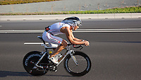 12 MAR 2011 - ABU DHABI, UAE - Romans Melderis  makes his way to the Yas Marina Circuit on his fist lap of the bike during the Abu Dhabi International Triathlon (PHOTO (C) NIGEL FARROW)