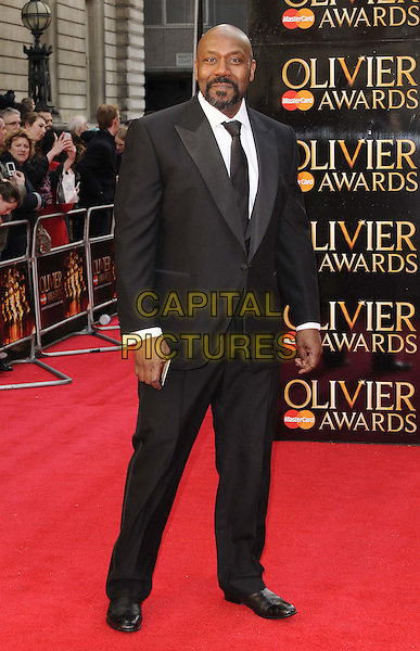 Lenny Henry.The Olivier Awards 2012, Royal Opera House, Covent Garden, London, England..April 15th, 2012.full length suit black white beard facial hair .CAP/CAN.©Can Nguyen/Capital Pictures.