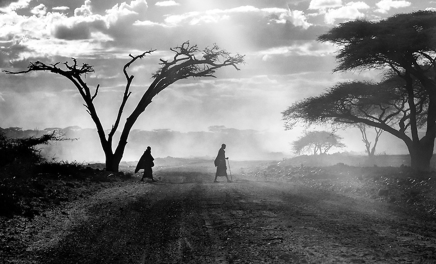 Driving through the Serengeti National Park in Tanzania, I was so struck by this scene of two Masai men silhouetted as they crossed the road in a cloud of dust. The moment felt so timeless and I was compelled to capture it.