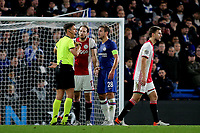 Daley Blind of Ajax and Chelsea's Cesar Azpilicueta speak to the referee, Gianluca Rocchi at half-time during Chelsea vs AFC Ajax, UEFA Champions League Football at Stamford Bridge on 5th November 2019