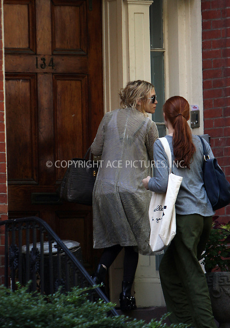 WWW.ACEPIXS.COM ** ** ** ....September 15 2008, New York City....Actress Mary-Kate Olsen (L) arriving at her West Village townhouse which she rents with her sister Ashley. The New York press have reported recently that their neighbors are less than thrilled to have the celebrity sisters in the street citing noisy parties, uncivil bodyguards and late comings and goings.....Please byline: STAN ROSE -- ACEPIXS.COM.. *** ***  ..Ace Pictures, Inc:  ..tel: (646) 769 0430..e-mail: info@acepixs.com..web: http://www.acepixs.com