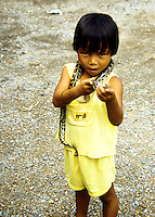 Young girl with snake at the Rose Garden in Bangkok, Thailand