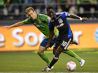 San Jose Earthquakes midfielder Simon Dawkins, right, and Seattle Sounders FC defender Tyson Wahl battle for the ball during play at CenturyLink Field in Seattle Saturday October 15, 2011. The Sounders FC won the game 2-1.