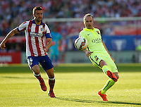 FC Barcelona´s  midfielder Andres Iniesta and Atletico Madrid´s Spanish midfielder Gab