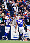 29 November 2009: Buffalo Bills' cornerback Drayton Florence (29) tosses the ball into the crowd celebrating his interception during a game against the Miami Dolphins at Ralph Wilson Stadium in Orchard Park, New York. The Bills defeated the Dolphins 31-14. Mandatory Credit: Ed Wolfstein Photo