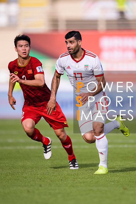 Mehdi Taremi of Iran (R) fights for the ball with Do Duy Manh of Vietnam (L) during the AFC Asian Cup UAE 2019 Group D match between Vietnam (VIE) and I.R. Iran (IRN) at Al Nahyan Stadium on 12 January 2019 in Abu Dhabi, United Arab Emirates. Photo by Marcio Rodrigo Machado / Power Sport Images