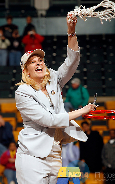 04 APR 2006:  Head Coach Brenda Frese of the University of Maryland cuts down the net after defeating Duke University during the Division I Women's Basketball Final Four Championship held at the TD Banknorth Garden in Boston, MA.  Maryland defeated Duke 78-75 for the national title.  Jamie Schwaberow/NCAA Photos